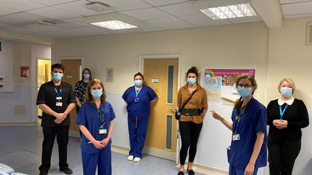Staff at a hospital standing two metre distanced
