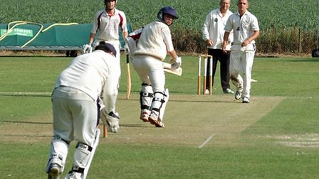 Tom Nudd taking one of his three wickets in Brooke's three-wicket win over Swardeston in the Carter