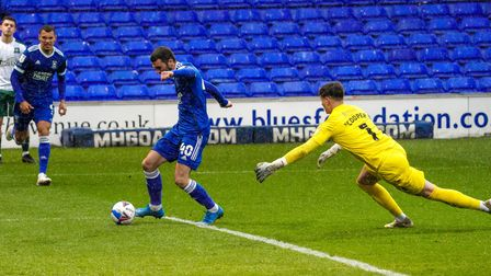 Troy Parrott rounds Plymouth keeper Mike Cooper to give Town a first half lead.
