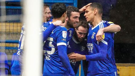Town players celebrate with Troy Parrott after he had given them a 1-0 lead.