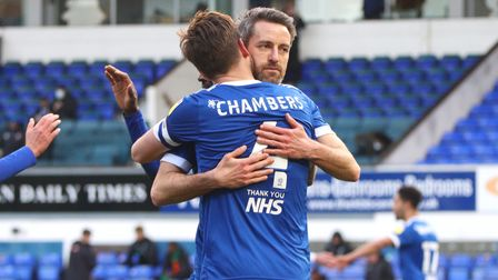 Luke Chambers and Cole Skuse embrace after the latter's return to action