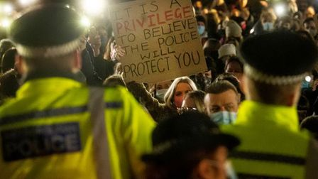 Police front up to demonstrators at a vigil for Sarah Everard in London
