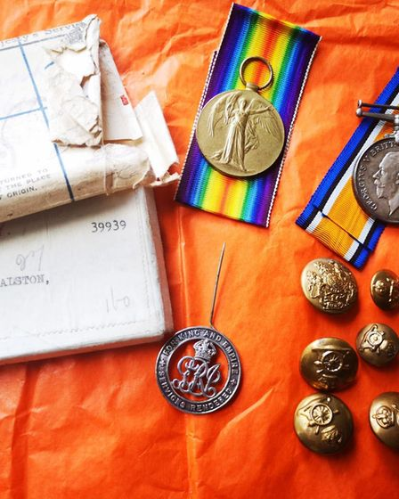 Adam Simpson-York works on tracing old war medals to their families