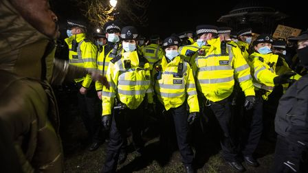 People clash with police as they gather in Clapham Common, London, after the Reclaim These Streets v