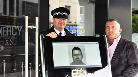 Chief inspector Nathan Clarke and Toby Middleton with the Scannet ID scanner now in use at Mercy nig