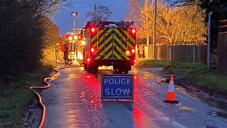 Norwich Road in Buxton was closed by Norfolk Police due to a fire at a property