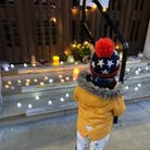 A child adds a candle to a Sarah Everard tribute onthe steps of Barking town hall.