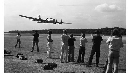 A crowd watching as a B-17 does a low fly-by at Woodbridge Air Show in 1976