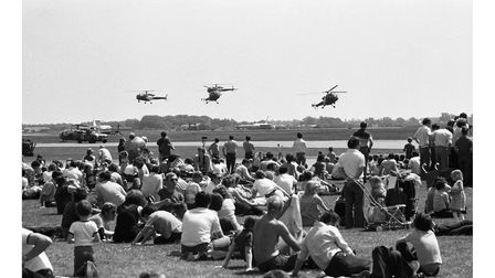 A squadron of helicopters hovering close to the ground at Mildenhall Air Fete in 1982