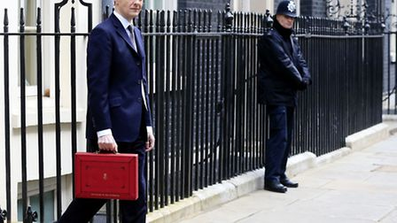 Chancellor of the Exchequer George Osborne outside 11 Downing Street, London, before heading to the