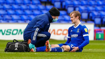 Flynn Downes receiving attention, ahead of going off with an injury.