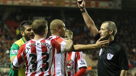 Wes Brown gets a red card from referee Martin Atkinson for a foul on Ricky Van Wolfswinkel during No