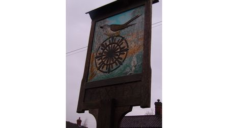 Yaxley's village sign, which pays homage to both its nickname and the Sexton's wheel which can be found in its church