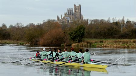 University of Cambridge boat crew work out along the River Great Ouse near Ely, Cambridgeshire.