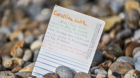Henry Fletcher has created a coralline cairn on Thorpeness beach, created from rocks collected duri