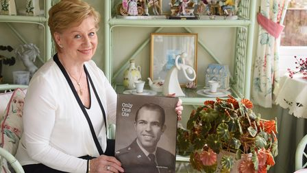 Nanette Olson with the book she has made about her husband, American pilot Bill 'Ole' Olson