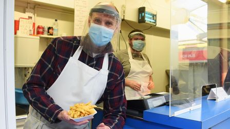 Rob Butcher, front, at Ron's Fish and Chips market stall, with Oliver Goldsworthy. Picture: DENISE B