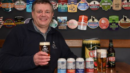 Woodeforde's brewery chief executive, Joe Parks, with two of their beer brands, Wherry and Fifty Two
