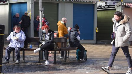 People out enjoying a bite to eat at Norwich Market. Picture: DENISE BRADLEY