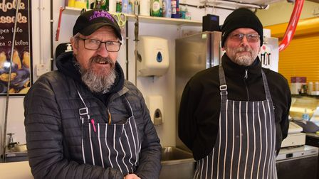 David Beech, left, and Stephen Boardley serving at their busy City Fish stall at Norwich Market. Pic