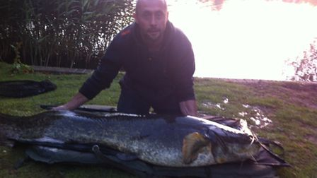 James Williams with the 100lb catfish caught in Diss Mere