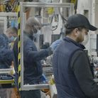 ford workers on the production line