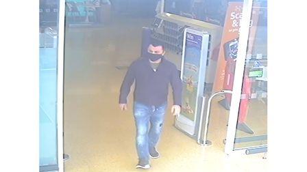 Police want to trace two men captured in CCTV after an elderly woman was the victim of theft outside a supermarket in Ipswich