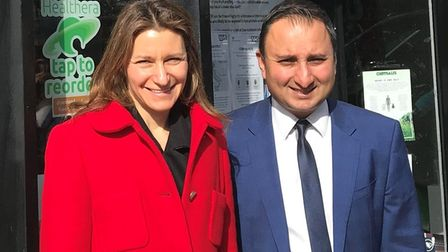 Anil Sharma (right) with Lucy Frazer MP outside Haddenham Pharmacy on Station Road. Picture: SUPPLIE