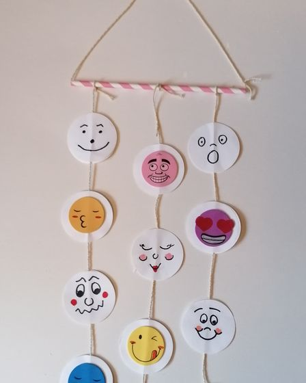 Mobile smiley art piece by Debbie Perriss.