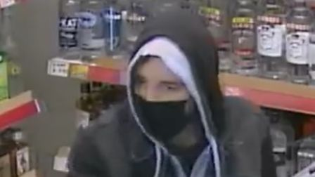 Suffolk police are trying to trace a man, following a knifepoint robbery in Haverhill