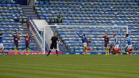 Marcus Harness celebrates scoring the winner at Portsmouth