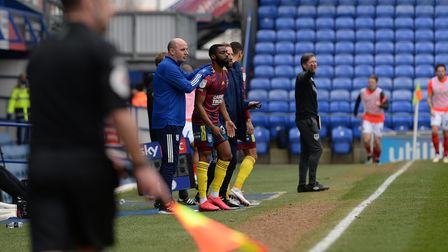 Ipswich Manager Paul Cook gives an emotional Kane Vincent-Young some support as he makes a substitut