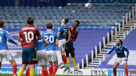 Toto Nsiala cannot direct a back post header at Portsmouth