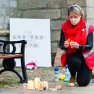 Jo Rust lights a candle in memory of Sarah Everard. Pictured: Ian Burt