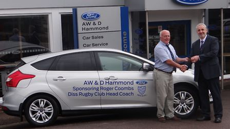 Paul Marjoram, dealer principal at A W & D Hammond Ford, handing over the sponsored car to Roger Coo