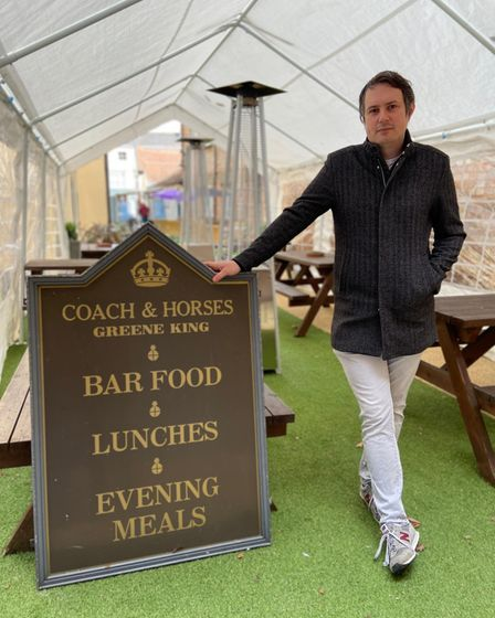Anthony Munro, landlord of the Coach and Horses, inside a marquee put up outside the pub ahead of its April 12 re-opening