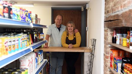 Daryn and Caroline Reffell of Sicklesmere post office are reopening, after it was destroyed by a fla