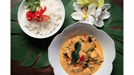 A bowl of Tom Yum curry and sticky rice garnished with chilli, from Lilian's Kitchen in Bury St Edmunds