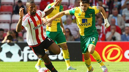 Robbie Brady of Norwich and Jeremain Lens of Sunderland in action during the Barclays Premier League