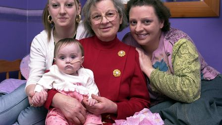 LITTLE KAYCHANEL WILLSON GETTING A KISS FROM HER MOTHER LOUISE ON HER FIRST BIRTHDAY HAVING OVERCOME