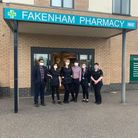 A team of people outside the pharmacy