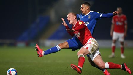 Charlton Athletic's Ben Watson (left) and Ipswich Town's Kayden Jackson battle for the ball during t