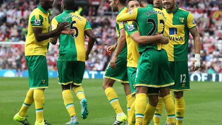 Nathan Redmond hugs Wes Hoolahan after his assist for Norwich City's third in a 3-1 Premier League w