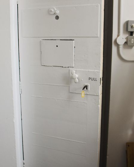 The cell door in the new RAF Coltishall Heritage Centre which was once the guardroom. Picture: DENIS