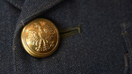 The top button on a WAAF wartime uniform which is actually a Polish button, in the new RAF Coltishal
