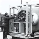 Hydramec founderPeter Church working on a large piece of equipment