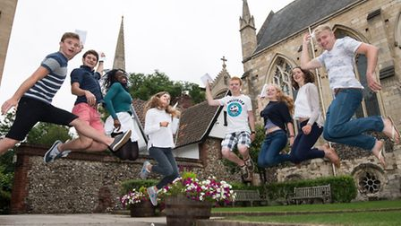 Students from Norwich School collect their A-level results this morning.