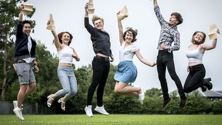 Pupils for Springwood High School in King's Lynn collect their A-level exams results. From left, Jos