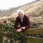 Rev Dr Mike Bossingham at the railway line at Hall Road in Cromer, where a bank of trees near the li