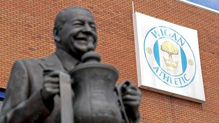 File photo dated 01-07-2020 of the Dave Whelan statue outside the DW Stadium, home to Wigan Athletic